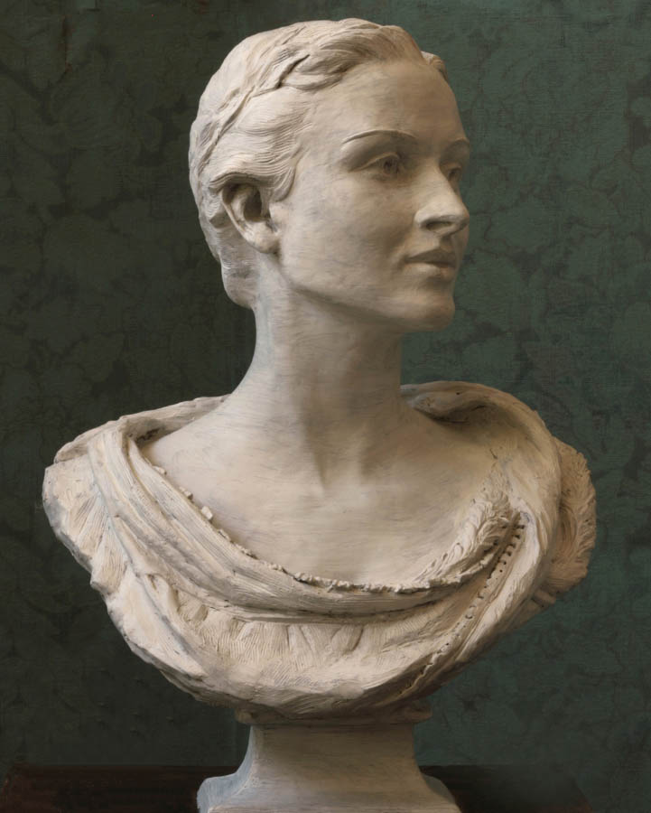 plaster bust sculpture of a woman with hair pulled back